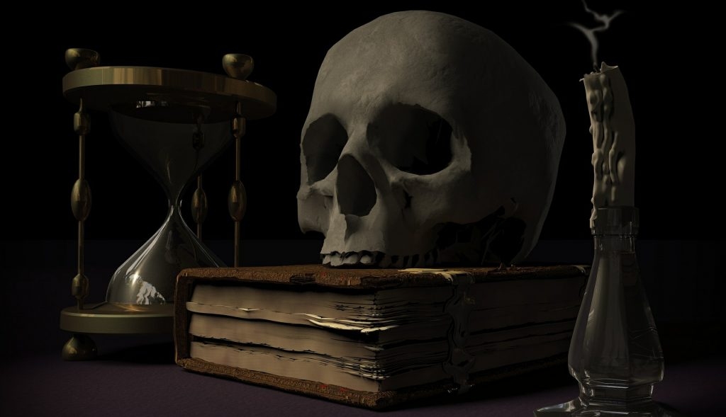 Picture of a skull, a book, an hourglass, and a candle.
